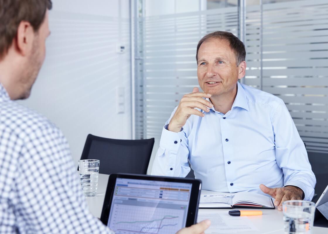 Besprechung mit Gerd Güssler